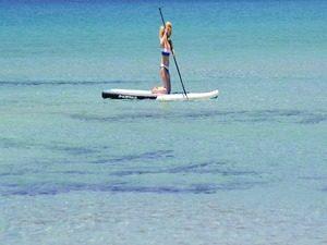 Paddle board cancun kneeling