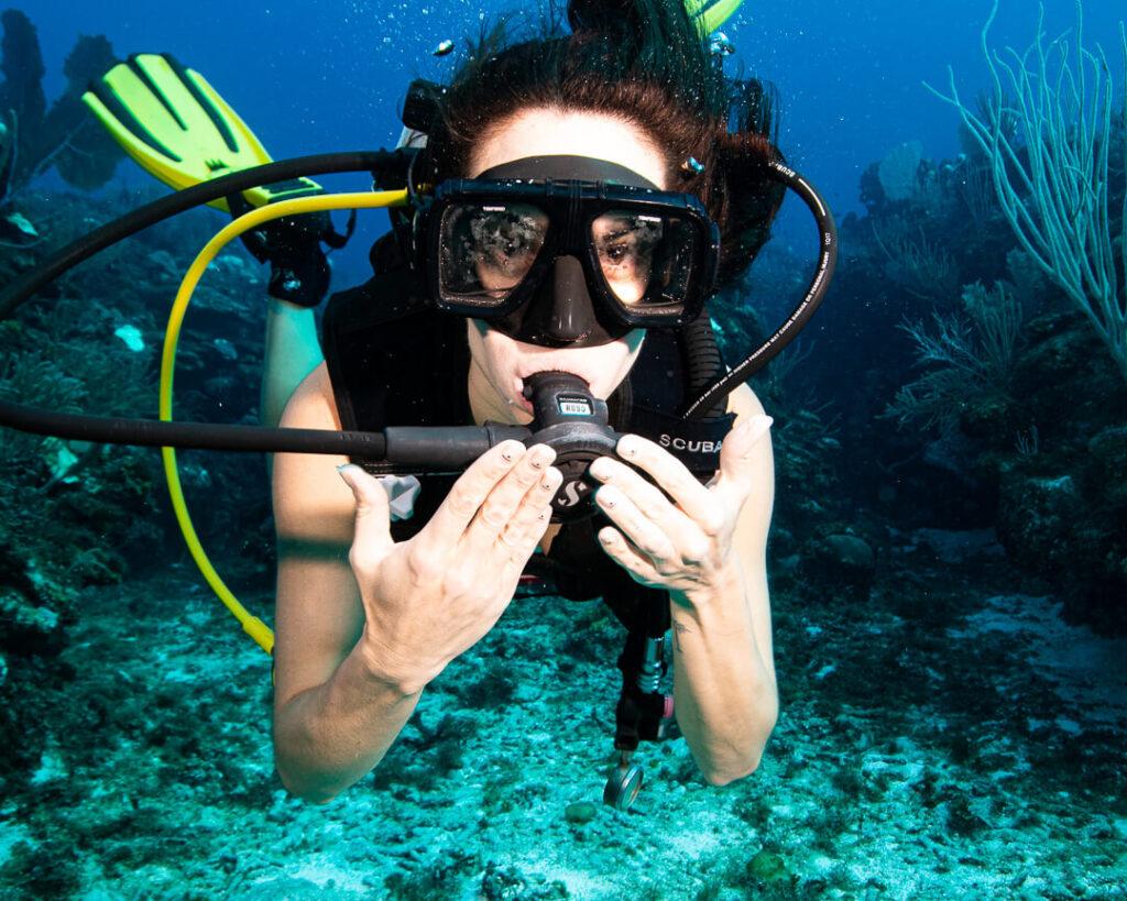 Women diver touching her regulator